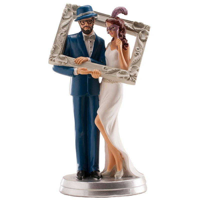 Maried couple figure holding a picture frame